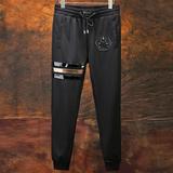 大码休闲长裤个性另类骷髅金属章拼皮条纹气质时尚纯棉潮牌型男装