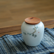 Green and white porcelain painted tea can ceramic sealed tea into the tea storage handmade tea silo natural flower pear wood lid.