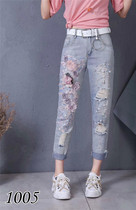 European goods ins Super fire female jeans fashion high waist heavy industry beaded three-dimensional flower loose nine points pants tide hole pants
