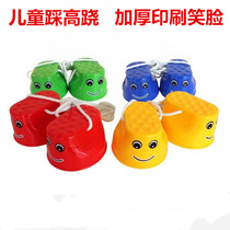 Shoot two send a child on stilts balance movement thickened print smiling face kindergarten fitness stilts shoes a pair of clothes