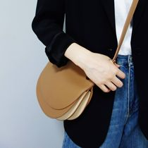 Choi Leather Factory homemade niche designer Head cowhide single shoulder saddle bag organ coloring leather woman bag